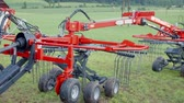 tenure : Brand new attachment is ready for work on grass which is located in a very nice environment on a very authentic countryside. Stock Footage