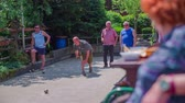 pár : LOCAL EVENT LUKOVICA AUGUST 2015: Few players playing  bouling game on sandy court which is located in the small village on countryside where have the fresh air.