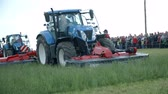 tenure : AGRICULTURAL FAIR EVENT DRAMLJE JULY 2015: Tractor is filmed during work on agricultural fair which is positioned in the middle of green nature on great landscape on countryside. Stock Footage