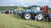 tenure : AGRICULTURAL FAIR EVENT DRAMLJE JULY 2015: Few tractor is standing on the agricultural fair which is positioned in the middle of green nature on great landscape on countryside. Stock Footage