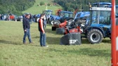 tenure : AGRICULTURAL FAIR EVENT DRAMLJE JULY 2015: Machinery is standing on the agricultural fair which is positioned in the middle of green nature on great landscape on countryside.