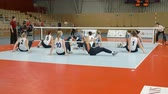 vela : EVENT PARA-VOLLEYBALL PODÄŒETRTEK 11.10.2015: In this video, we can see how one volleyball player falls on her back from a sitting position. Wide-angle shot.