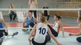 saraivada : EVENT PARA-VOLLEYBALL PODÄŒETRTEK 11.10.2015: In this video, we can see how a volleyball player is serving the ball. Close-up shot. The team is successful and get points. Stock Footage