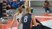 saraivada : EVENT PARA-VOLLEYBALL PODÄŒETRTEK 11.10.2015: In this video, we can see how two players are giving high-five to each other during a volleyball tournament. Close-up shot. Stock Footage