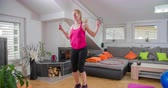 sorts : Jumping rope is a fun way to work out. This lady is doing all sorts of exercises at home to really sweat out: yoga, working out on orbit track, etc.