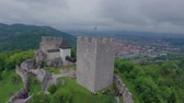 curso : EVENT URBANI GLADIATOR CELJE 2016 A beautiful big castle is overlooking the city that is located in the distance. The fortress looks magnificent. Wide-angle shot.