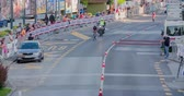 načasování : MARATON FRANJA 2016: The first cyclist is coming closer to the finish line. There are people on both sides of the street. Wide-angle shot. It is a nice summer day. Dostupné videozáznamy