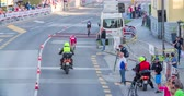 načasování : MARATON FRANJA 2016: A young cyclist is driving in front of a motorcyclist. There is also a car driving behind them. The audience is watching from all sides. Wide-angle shot. Dostupné videozáznamy