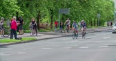 načasování : MARATON FRANJA 2016: Two cyclists are driving together in a bicycle race. Many people are cheering for them and clapping in the background. Close-up shot.