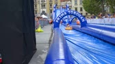 bastante : EVENTS IN LJUBLJANA JULIJ-AVGUST 2016 There is not enough water for kids to go down the water slide which is located right in the city center in the capital of Ljubljana. It is summer time.