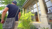 local de nascimento : A visitor who came to see the architect Plecniks house is walking around the house and he is observing the area. Close-up shot. It is summer time. Stock Footage