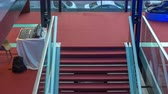 экспонат : Modern staircase in red carpet flooring surrounded with protective glass fence. Стоковые видеозаписи