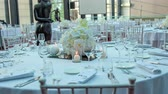 dining table : Amazing scene ready for a wedding celebration. Round tables are all decorated in white with beautiful and fancy white bouquets.