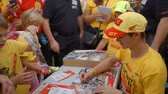 nadšení : A young star of the motorcross racing is signing posters for the children. They are all very happy because he is taking time and signing them for them.