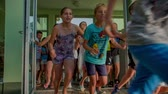 seção : GRIZE, SLOVENIA - 10. JUNE 2017  Boys push the door and everyone runs out. They are having a day full of sports on the sport facility outside the school.