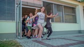seção : GRIZE, SLOVENIA - 10. JUNE 2017  Happy kids are starting their summer vacation. They open the school door and run out. Stock Footage