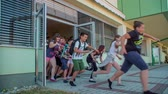 seção : GRIZE, SLOVENIA - 10. JUNE 2017  Children are running out the school facility as fast as they can. Its summer time and the school year is over.