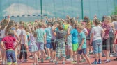 seção : GRIZE, SLOVENIA - 10. JUNE 2017  Kids are gathered together on a sport facility and are waving at someone. Stock Footage