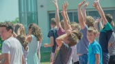 seção : GRIZE, SLOVENIA - 10. JUNE 2017  Children are gathered together and they are waving at someone. Its summer time.