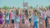 seção : GRIZE, SLOVENIA - 10. JUNE 2017  Kids are standing on the red sport facility and are waving at someone. Its summer time. Stock Footage