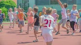 seção : GRIZE, SLOVENIA - 10. JUNE 2017  Children are happy and joyful. They are running and playing on the sport facility. Its summer time.