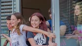 seção : GRIZE, SLOVENIA - 10. JUNE 2017  Kids are pushing the front door of the school and are running out happily. The summer is finally here. Stock Footage