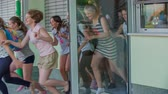 seção : GRIZE, SLOVENIA - 10. JUNE 2017  The school door opens and everybody runs out. The summer holidays are here.