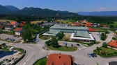 seção : GRIZE, SLOVENIA - 10. JUNE 2017  A church and a school are located in the middle of a village. Aerial shot. Its summer time. Stock Footage