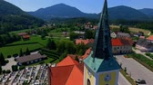 seção : GRIZE, SLOVENIA - 10. JUNE 2017  A clocher on a church. There is also a cemetary next to the church. Aerial shot.