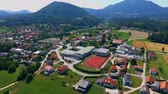 işe : GRIZE, SLOVENIA - 10. JUNE 2017  There is a big red sport facilty lying in the middle of a village in Slovenia, next to a primary and secondary school. Stok Video
