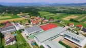 işe : GRIZE, SLOVENIA - 10. JUNE 2017  A big school is situated in the middle of stunning nature. Aerial shot. Its summer time. Stok Video