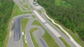 kaygan : A safe driving center in Slovenia. Its spring time. Everything is green. Aerial shot. Stok Video