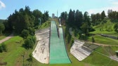 disiplin : Breathtaking ski jumps for extreme sportsmen placed on a top of a hill in Velenje, Slovenia.