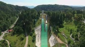 crazy : Two amazing ski jumps situated on a hill and ready for active and extreme sportsmen. Stock Footage