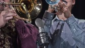 trumpet : Young and elderly trumpetists perform on the stage, play the music instrument and entertain the audience. Stock Footage