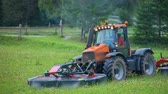 mowing : A tractor starts and it is ready to start driving. Stock Footage