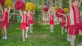 matraque : Girls are really cute practising their routine for the school performance. Vidéos Libres De Droits