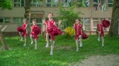 rytmický : Primary school girls are practising their routines for the school performance. Theyre dancing in the school yard.