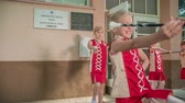asa : School kids are practising dancing with majorette sticks.