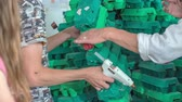 School children are making something from egg carton at their classes in school. They coloured all cartons green.