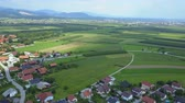 szlovénia : A green landscape and a small village. Aerial shot. Slovenia is a really beautiful small country in the heart of Europe. Stock mozgókép