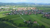 serio : A small village in the middle of Slovenia. It is really gorgeous. Aerial shot. Its summer time. Archivo de Video