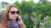 Woman talking in the park on mobile phone
