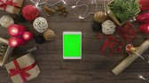 christmass : Top view using digital tablet tap at wooden desk from above with christmass decoration Stock Footage