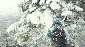 śnieżka : Young happy girl playing with snow in the winter park, outdoor sunny day slowmotion Wideo