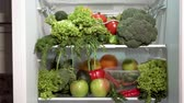 leeks : Closeup of full fridge, fresh and colorful vegetables in the refrigerator, rich nutrition food Stock Footage