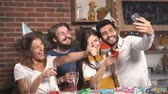 surprised : Cheerful friends taking selfie at the birthday party, good-looking young people celebrating important event after work in spacious flat Stock Footage