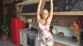 delighted : Delighted beautiful girl dancing in kitchen, indoor shot in rich modern accommodation