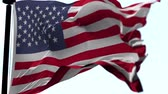 conquest : Animation of US flag blowing in the wind in slow motion, loopable American symbol against blue sky