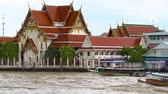 chao phraya : Tourist boats on the Chao Phraya river, Bangkok, Thailand. Wat Rakang Kositaram Buddhist temple compound.